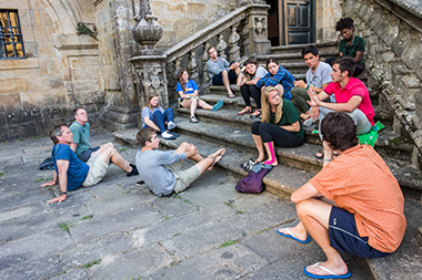 Clockwise, from left: Leaders Bloechl and Corcoran, Chadwell, Albyn, Olander, Muir, Bolanos, Holterman, Banks (top step), Street (red shirt), Piperis (flip-flop), Krakowiak, and Piper, during final reflections in Santiago de Compostela, on June 3. Click image to enlarge.