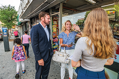 Parsons with Christopher Panczner, a Montefiore system senior vice president, outside the Bronx New Way Deli & Grocery. The bodega is located a mile and a half from the Medical Center.
