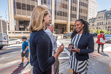 Mokoban (right) outside the attorney general's office with Madeline Raster, an intern from Harvard. Image: Lee Pellegrini