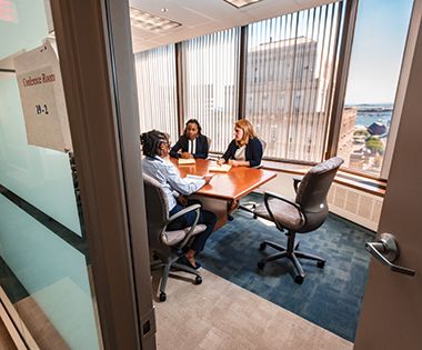 In a 19th-floor conference room with Raster and intern Danielle Miles-Langaigne from the University of Pennsylvania. Image: Lee Pellegrini