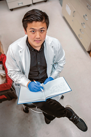 Yan with his lab notebook. Image: Daniel Kramer