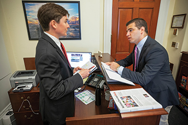 Martinez (right), with press aide Benjamin Cole, in Congressman Vela's office. Image: Mark Finkenstaedt
