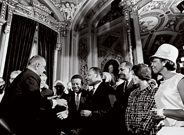 LBJ greets (from left) Ralph Abernathy, Martin Luther King, Jr., Clarence Mitchell, Jr., and Patricia Roberts Harris in the U.S. Capitol after the act's signing. Photograph: Yoichi Okamoto/Corbis