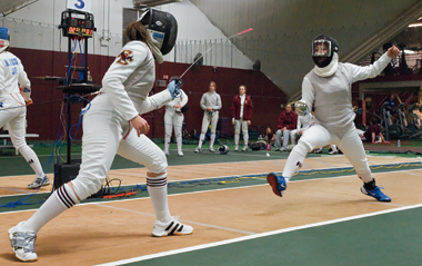 Foil fencer Jennifer Colacino '11 prepares to parry a move by Harvard's Emily Cross, a silver medalist in Beijing.