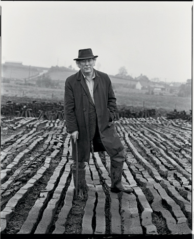 One of Hanvey's most-photographed subjects (some 1,000 shots and counting), poet Seamus Heaney stands in a field of peat turves in Bellaghy, a village in County Londonderry, where he lives. Heaney is wearing his father's coat and hat. The walking stick was his father's as well (1986).