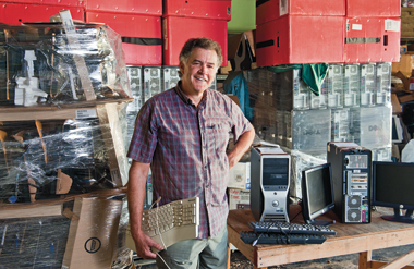 Anderson at a storage facility near his home, with hardware ready to ship. Photograph: Gary Wayne Gilbert
