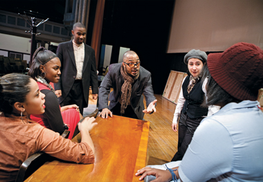Simeon Buresch (center) backstage with student-actors at Manhattan's Gramercy Arts High School prior to a performance of Six Characters in Search of an Author, which he directed. Photograph: Donna Alberico. Click to enlarge.