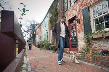 Rufus Caine III takes Kennedy for a walk along the C&O Canal in Washington, D.C. Photographer: Mark Finkenstaedt. Click to enlarge.