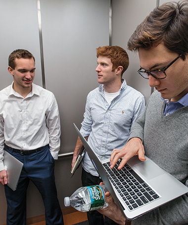 Lacoste (left), Coburn (center), and McAleese ride the elevator to Jebbit's offices in the historic Landmark building in Boston. Photograph: Lee Pellegrini