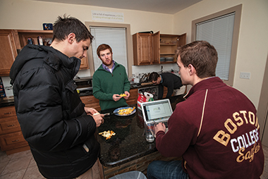 Breakfasting at Jebbit House are, from left, residents Kevin Gawron '16 (on leave), Coburn, McAleese, and Lacoste. Gawron directs Jebbit's customer service. Photograph: Lee Pellegrini