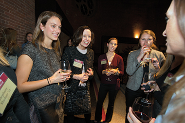 On December 3, from left: Sarah Taddei '13, chair of Boston College's Board of Trustees Kathleen McGillycuddy NC'71, Ashley Driscoll '11, Elizabeth Zappala '13. Photograph: Rose Lincoln