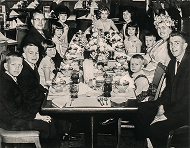 The Fitzgibbonses at the Colonial Restaurant in Lynnfield, Massachusetts, on Mother's Day 1961. Clockwise from left: Dan, Bryant, Jean, Daniel, Sr., Joan, Corinne, Maryanne, Joyce, Lisa, Andrew, Jean, Lane, and John. Photograph: Courtesy of Joyce Fitzgibbons. Click image to enlarge.