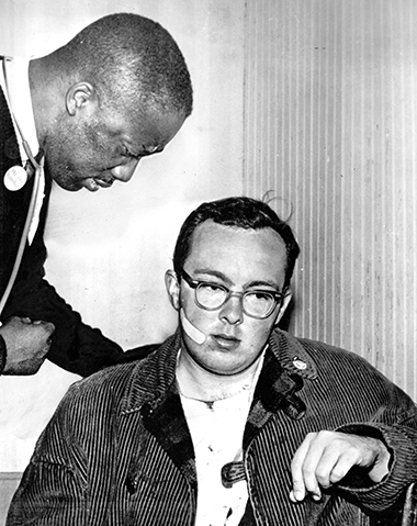A doctor examines Leo Haley after he was attacked on Saturday, March 20. Photograph: Associated Press