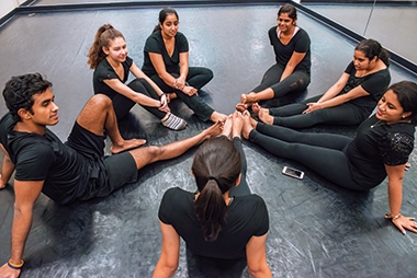 Unwinding in the Brighton Dance Studio. Clockwise from left: Arivudainambi, Craparotta, Shrivastav, Patel, Shanbhag, Ratnaseelan, and Parashar. Click image to enlarge.
