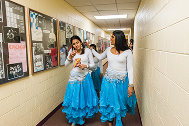 Parashar (left) and Patel in Robsham en route to dress rehearsal. Click image to enlarge.